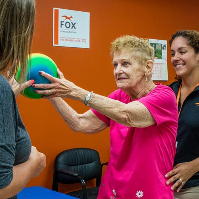 Elderly lady doing physical therapy