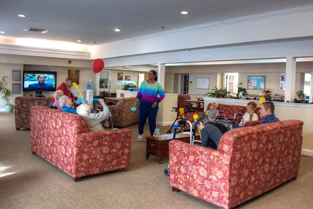 Residents having activity period in our main communal room.