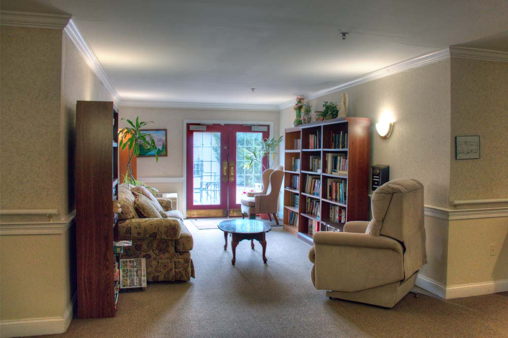 One of several small sitting areas. This one has a selection of books and a view to the garden.